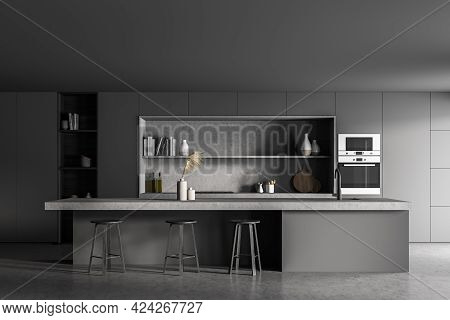 Black Kitchen Room With Black Table And Three Bar Chairs, Front View, Concrete Floor. Cooking Set In