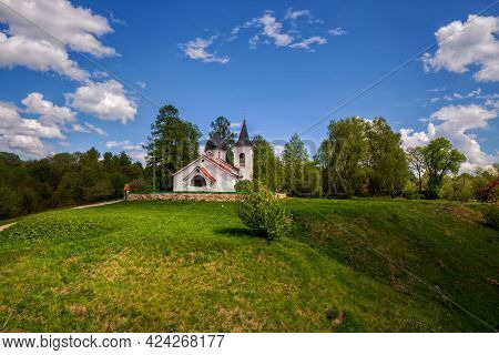Picturesque Summer Landscape. Church Of The Holy Trinity In The Village Of Bekhovo Near The Polenovo