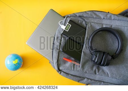 Modern Gadgets Smartphone, External Battery And Laptop Lie In Fashionable Textile Backpack Next To