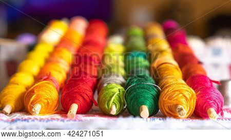 Close-up Sewing Threads Of Different Colors. Home Hobbies Authentic. The Arts Authentic Hobby