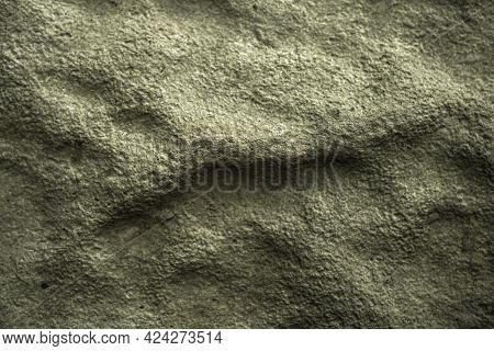 Bumpy And Rough Concrete Block Surface. Dark Aged Background Or Wallpaper. Olive Or Gray-green Backd