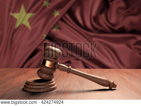 Wooden Judge's Gavel Symbol Of Law And Justice With The Flag Of China. Supreme Court. 3d Rendering