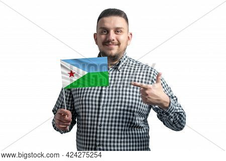 White Guy Holding A Flag Of Djibouti And Points The Finger Of The Other Hand At The Flag Isolated On