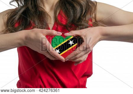 Love St. Kitts And Nevis. The Woman Holds A Heart In The Form Of The Flag Of St. Kitts And Nevis On