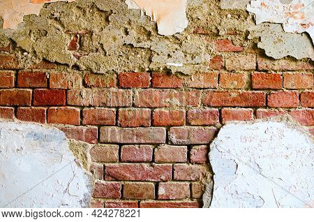 Old Red Brick Wall. Painted Distressed Wall Surface. Grungy Brickwall. Grunge Red Stonewall. Shabby