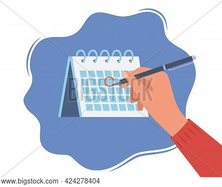 Hand With Pen And Calendar. Person Draws Red Mark Around A Date In The Calendar. Desktop Calendar Wi