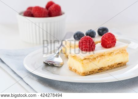 Traditional Swiss Custard Slices With Icing (cremeschnitte In German) With Fresh Berries, Close Up