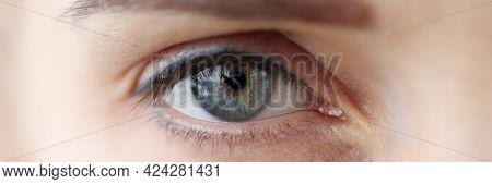 Womans Eye With Permanent Eyelid And Eyebrow Makeup Closeup