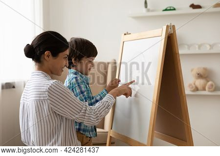 Happy Indian Mom And Small Son Draw On Whiteboard