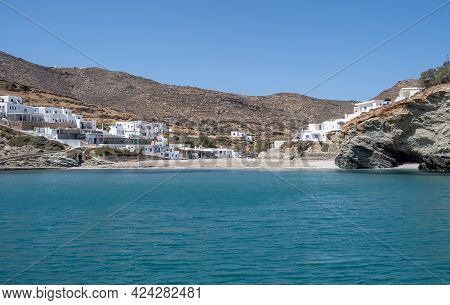 Folegandros Sandy Beach Agkali, White Buildings And Blue Sky Background. Summer Holidays At Cyclades