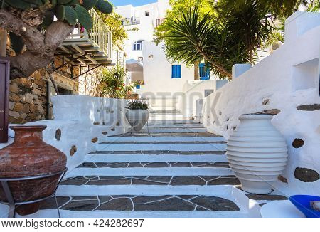 Houses Whitewashed Walls Sunny Day At Sifnos Island, Greece. Stone Stairs Background.