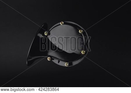 Electric Horn For Car, Snail Shaped Horn, Isolate On Black Background, Close-up, Selective Focus