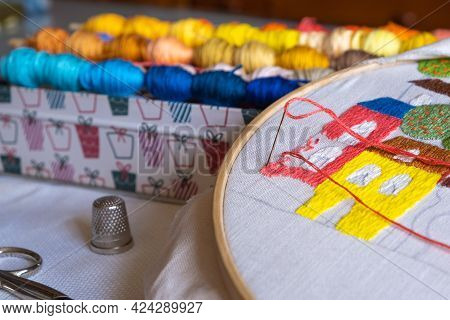 Close-up Of A Thimble, Sewing Scissors, Threads And Hoop. Sewing And Tradition. Home Hobbies Authent