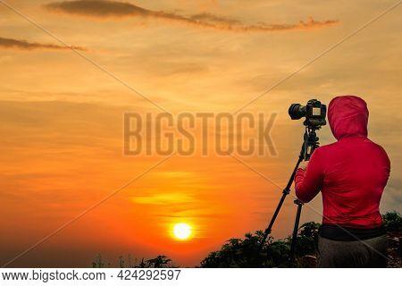 Photographer Taking Thailand Travel Twilight Sky Photography. Woman Photographer Shooting With Tripo
