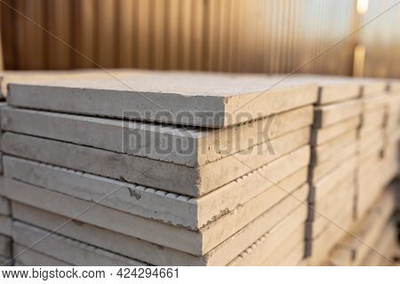 Large Square Paving Slabs In Stack At Construction Site. Backyard, Driveway Or Sidewalk Pavement Mat