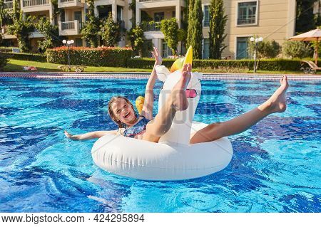 A Girl In An Inflatable Circle In The Form Of A Unicorn Swims Near The Hotel