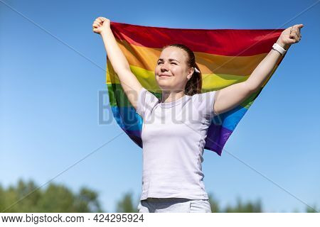 Portrait Of Young Lesbian Happy Proud Woman, Beautiful Girl Is Waving Rainbow Lgbt Color Gay Flag In