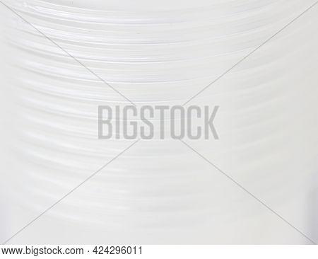 White Fuzzy Background With Blurry Image Of Corrugated Tube