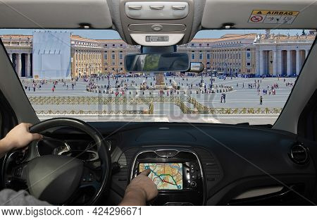 Driving A Car While Using The Touch Screen Of A Gps Navigation System In The Scenic St. Peter's Squa