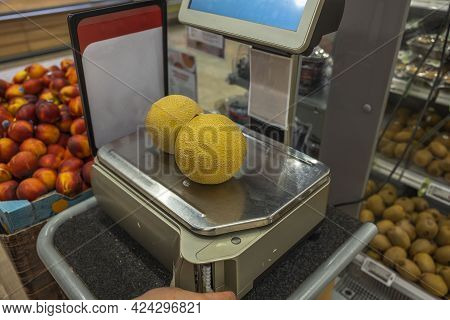 Close Up View Of Yellow Melon On Weighing Scales In Supermarket. Sweden.