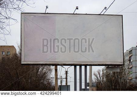 Blank Roadside Banner In Front Of City Buildings. Blank Presentation Media Mock Up Template Poster.