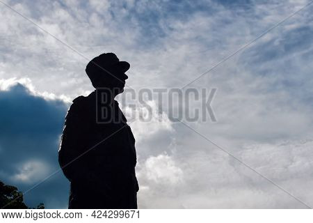 Paris, France - November 13, 2020: A Monument Of Charles De Gaulle On Background Of Blue Cloudy Sky