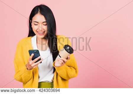 Happy Asian Portrait Beautiful Cute Young Woman Excited Smiling Holding Mobile Phone And Coffee To G