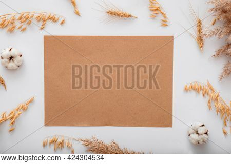 Earthy Beige Color Blank Craft Paper Card Note Invitation Mockup With Mockup Dried Cotton Flowers Ce