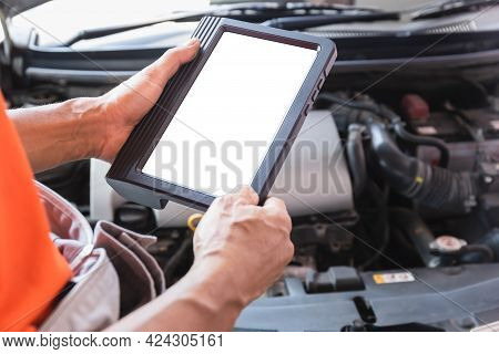 Auto Mechanics Are Examining Car While Working In Auto Service, Technician Doing The Checklist For R
