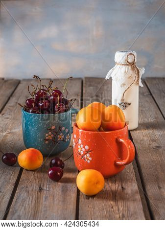Fruit Light Breakfast With Yoghurt And Fruits, Cherries And Apricots In Ceramic Mugs