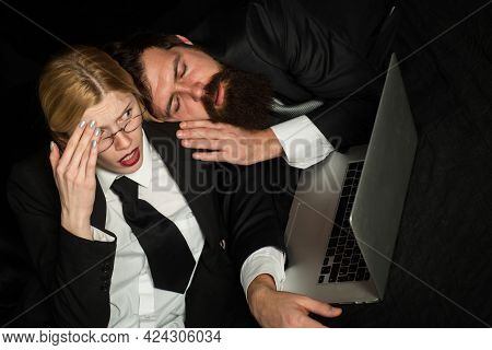 Tired Businessman Sleeping In Dark Office, Young Business Woman Overworked At Office. Portrait Of St