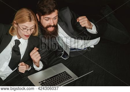 Portrait Of Two Excited Business People Looking At A Laptop Screen. Hackers Using Laptops. Hackers H