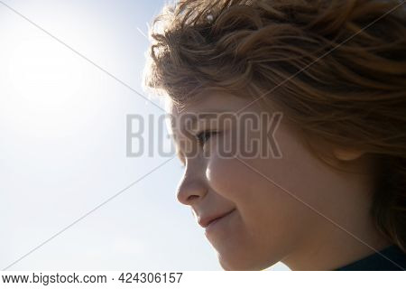 Close-up Portrait Of Cheerful Child. Cute Joyful Little Boy Kid. Close Up Profile Portrait Of Funny