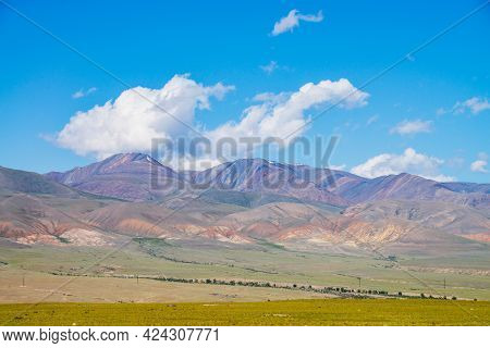 Colorful Alpine Scenery With Big Multicolored Mountains Under Blue Sky In Sunny Day. Vivid Mountain