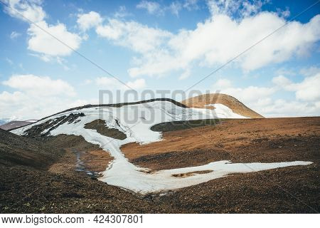 Sunny Mountain Desert Relief With Glacier In Sunlight Under Blue Cloudy Sky. Scenic Highlands Landsc