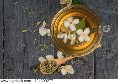 Flower Tea With Jasmine Petals Brewed In A Glass Bowl. An Invigorating Drink That Is Good For Your H