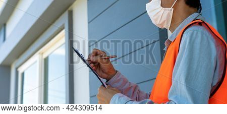 Inspector Or Engineer Is Checking And Inspecting The Building Or House By Using Checklist. Engineers