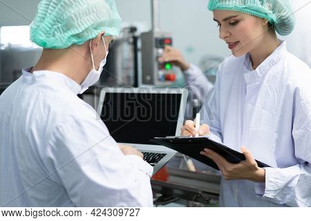 A Quality Supervisor Or A Food Or Pharmaceutical Technician Inspects The Quality Of Food And Drugs B