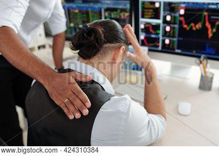 Trader Patting Sad Desperate Collegue On Back Reassuring Him After He Made Bad Investment