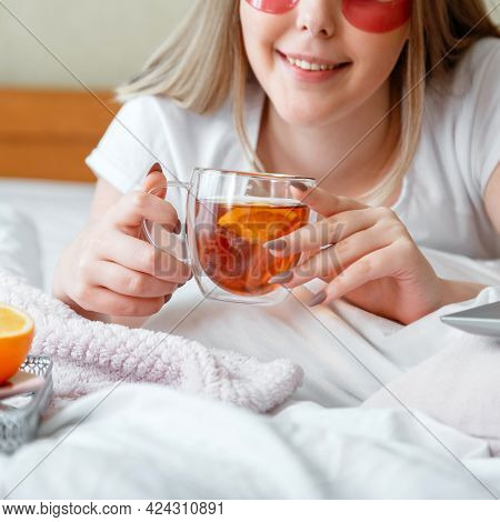 Cup Of Black Tea In Female Hands. Young Woman Have Breakfast, Drinks Tea. Morning Routine Breakfast