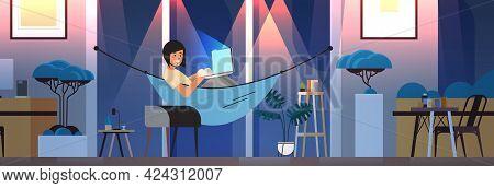 Overworked Businesswoman Freelancer Looking At Computer Screen Girl Lying In Hammock Dark Night Home