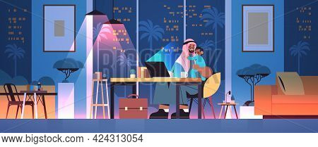 Busy Arab Father Freelancer With Little Son Looking In Laptop Screen Freelance Fatherhood Concept