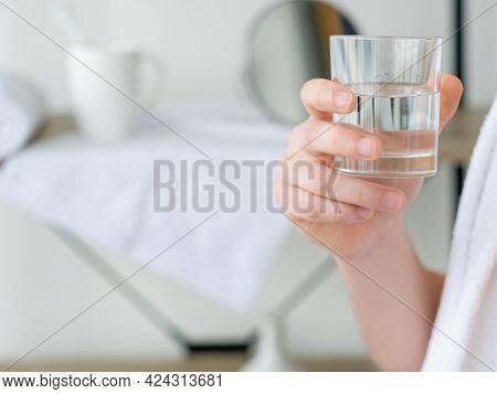 Clean Water. Hydration Diet. Healthy Body. Unrecognizable Man Hand Holding Glass With Transparent Cl