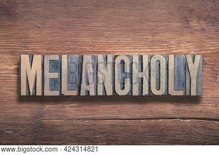 Melancholy Word Combined On Vintage Varnished Wooden Surface