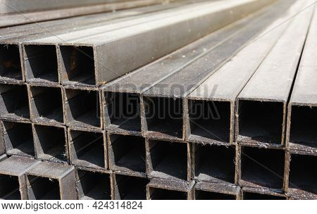 Metal Square Profile In A Stack, Metal Pipes Of Square Cross-section On The Site Of A Building Mater