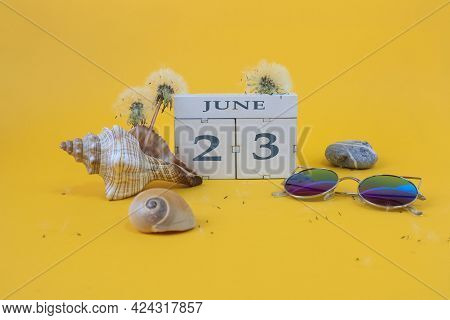 Calendar For June 23: Cubes With The Number 23, The Name Of The Month Of June In English, Shells, Se