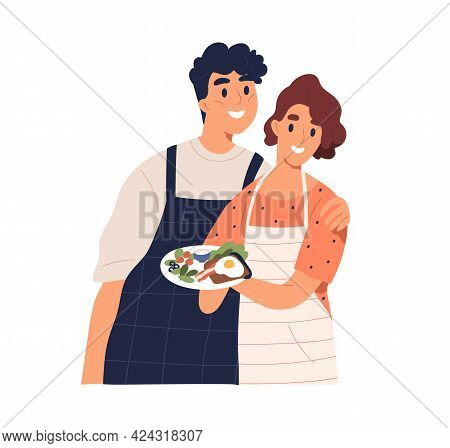 Couple Of Happy Man And Woman Holding Plate With Cooked Food. Portrait Of Smiling And Hugging Husban