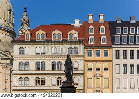 Dresden, Germany - September 11, 2020: Statue In Front Of Colorful Houses In Dresden, Germany