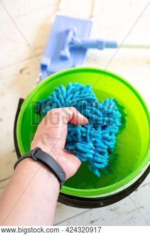 Washing A Doormat In A Bucket Of Water. Room Cleaning.
