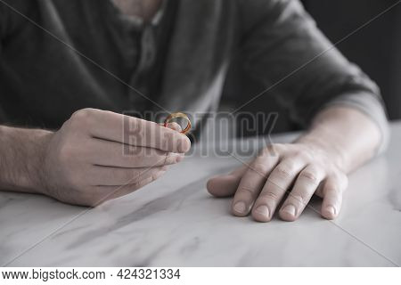 Man With Wedding Ring At Table, Closeup. Cheating And Breakup